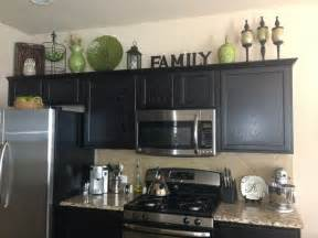 Kitchen Cabinets Decor Home Decor Decorating Above The Kitchen Cabinets Kitchen Decor Green Black Brown Color