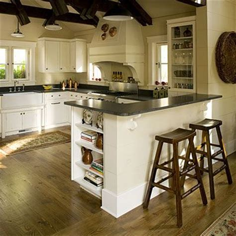 The Cozy Kitchen by Reclaimed Pine Flooring Flows From The Adjacent