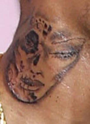 chris brown neck tattoo meaning chris brown claims neck is inspired by day of the