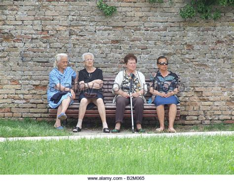 people sitting on bench men chat park bench stock photos men chat park bench stock images alamy