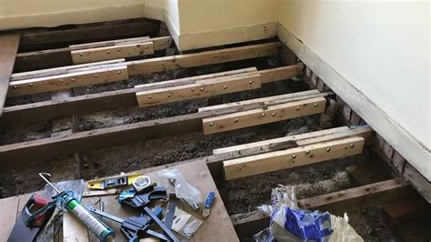 how to level a house sistering floor joists youtube