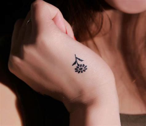 small flower wrist tattoo tattoos and designs page 2