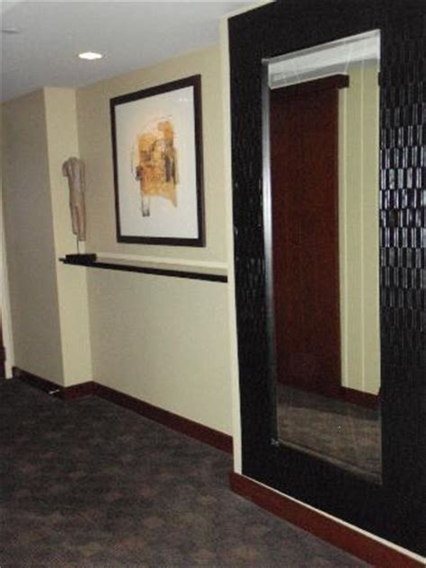 hallway with large mirror picture of hotel 1000