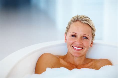 women in bathroom cute mature woman relaxing in the bathtub monika hoyt