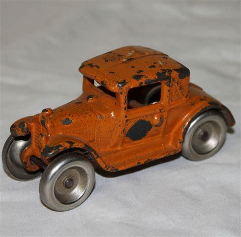 Bargain John's Antiques   Orange Antique Cast Iron Arcade