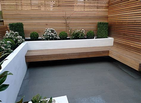 modern garden bench designs replace the garage area with this wind sheltered sitting