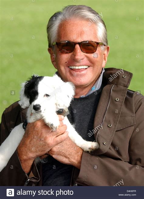 us actor george us actor george hamilton poses with his crossbreed dog