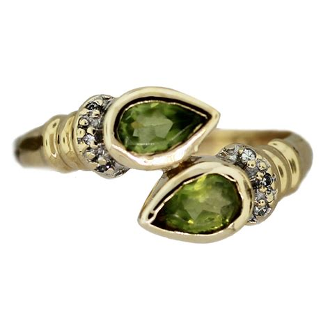 Ring Peridot 14k yellow gold and pear shape peridot ring boca raton