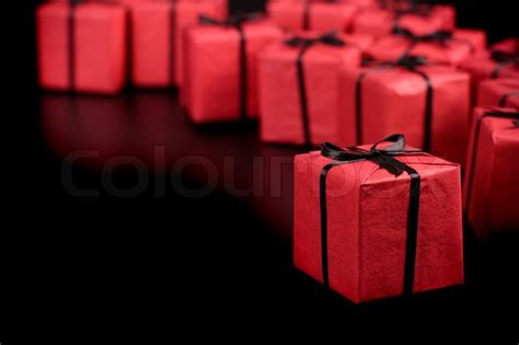red gift boxes  black background stock photo