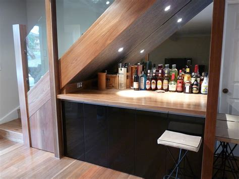 under stair bar 21 genius design ideas for the space under your stairs