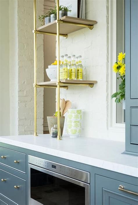 gray butler pantry shelves fitted  brass knobs