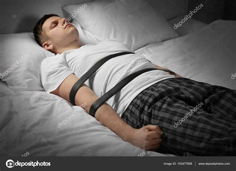 tied up in bed young man tied up with belts in bed stock photo 169 belchonock 153477808