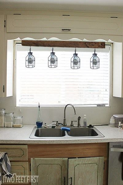 lighting  kitchen sink inspiration twofeetfirst