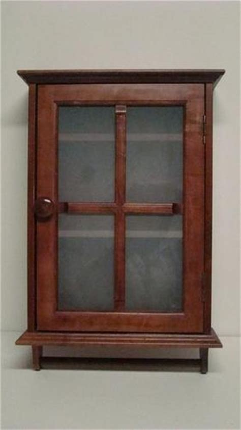 wood medicine cabinet with towel bar browns and neutrals