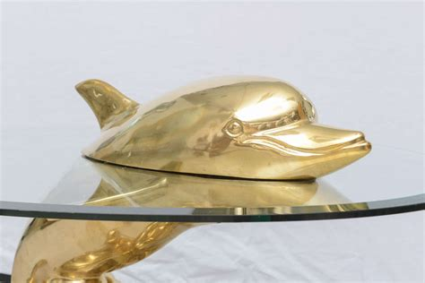 vintage polished brass dolphin coffee table at 1stdibs