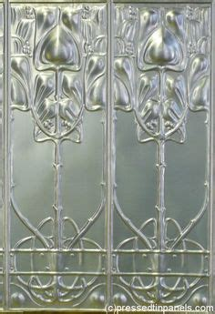 Din Avi 1800 H Glass Panel wunderlich pressed metal ceiling tile in waratah pattern with strong nouveau influence