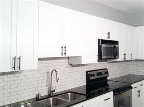 bright white kitchen with bronze hardware pictures to pin diy let there be light dwell with dignity