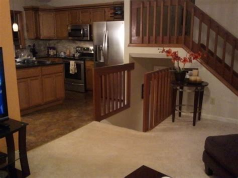 basement stairs in living room banisters for a split level home transitional style