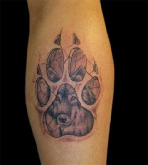 wolf paw print tattoo designs cracked wolf paw print on leg paw on thigh