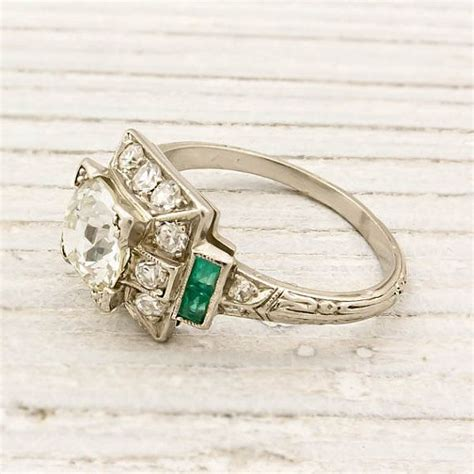 beautiful antique estate ring with diamonds and emerald