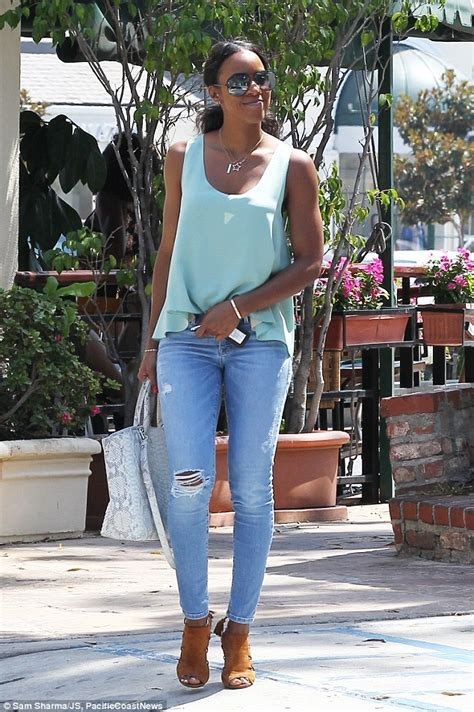 kelly rowland in a white tank top highlighing derriere in kelly rowland looks casual but cool in torn jeans and