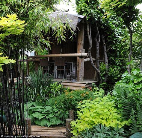 creates paradise garden with banana plants and