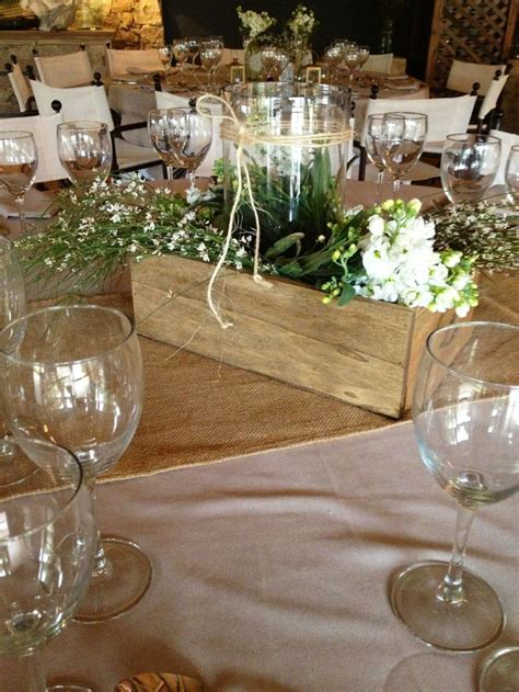 Country wedding centerpiece but use ball/mason jars and
