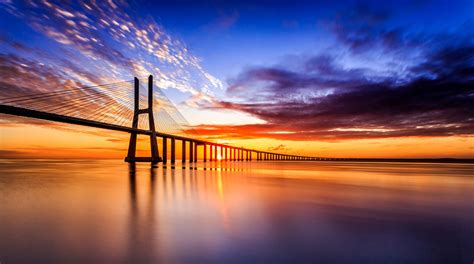new day the colors of a new day ponte vasco da gama lisboa flickr