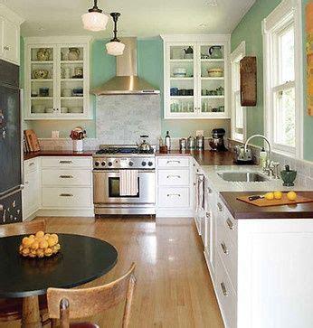 white cabinets butcher block countertop kitchen