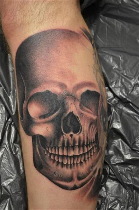 freaky tattoo designs realistic leg skull by colours