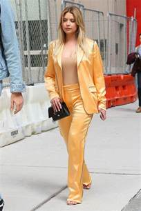 benson chic style leaving an office building in