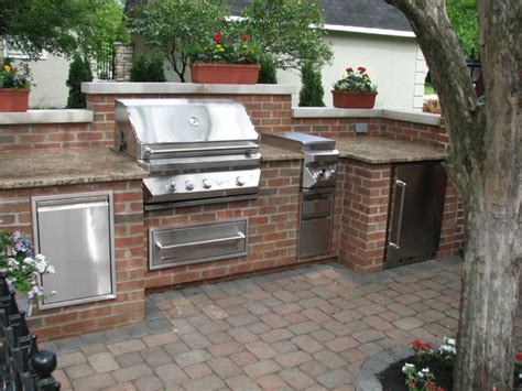 brick granite limestone outdoor kitchen traditional patio columbus by aspen fireplace