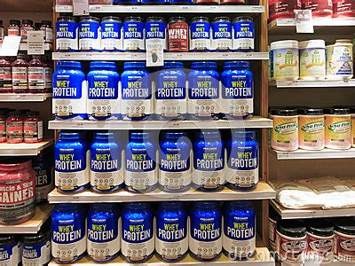 Shelf Of Whey Protein by Whey Protein Jars On Store Shelf Editorial Stock Image