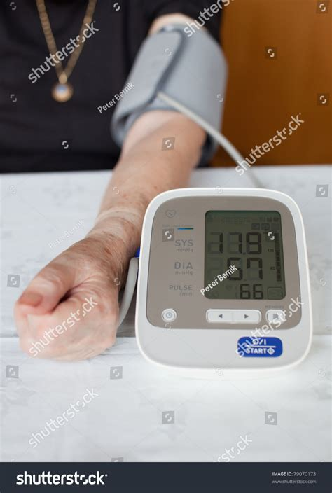 senior measuring blood pressure stock photo