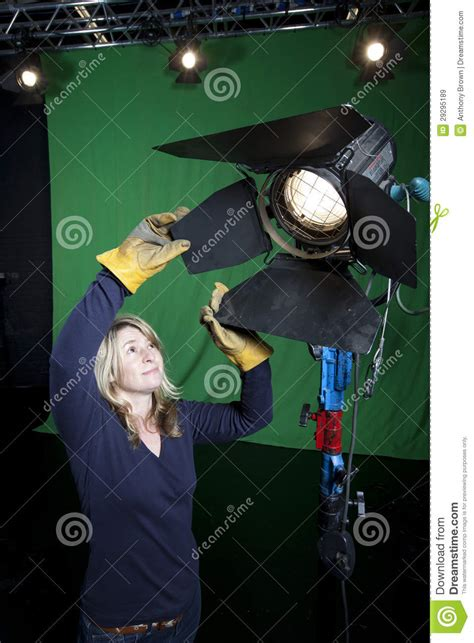 Lighting Technician by Lighting Technician In Television Studio Royalty Free