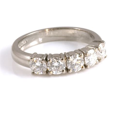 18ct white gold claw set half eternity ring from