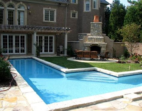 pool with outdoor fireplace design idea and decorations