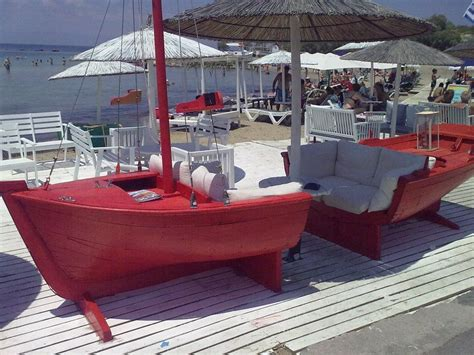 old boat turned into unique bar sofa boat that s neat maybe a sail could be made into