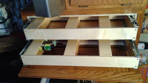 Pull Out Shelves For Kitchen Cabinets by Verticle Roll Out Shelves Help Your Shelves