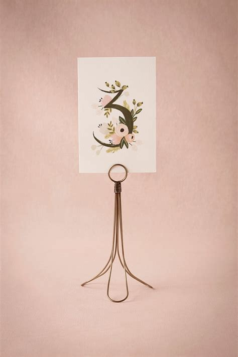 brass table number holders brass card holder from bhldn fall wedding ideas