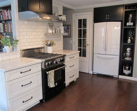 White Kitchen Cabinets With Black Appliances Joyce S Black White Kitchen Hooked On Houses