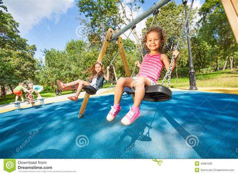 the swing girls kids swing on playground stock image image of happy