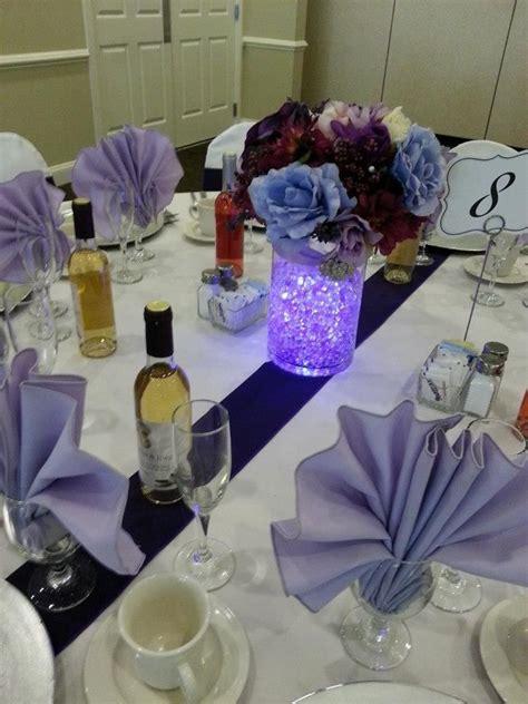 purple water centerpieces purple water and flowers centerpiece