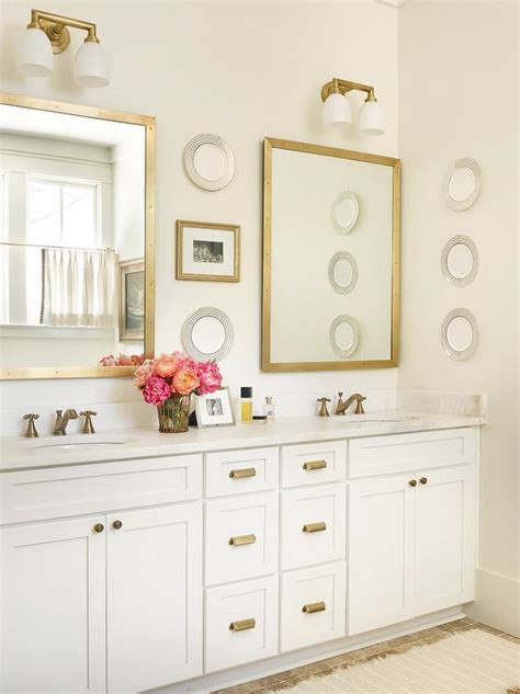 white cabinets with antique brass hardware white and gold bathroom with brass rivet medicine cabinets