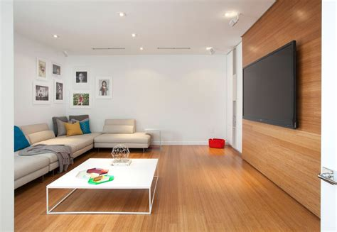 contemporary home theater with wood wall laminate floors