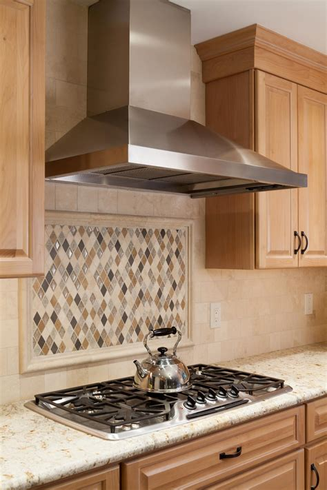 kitchen with shaped tile backsplash and stainless