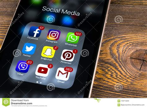 apple iphone   wooden table  icons  social media facebook instagram twitter snapchat