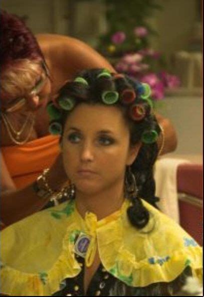 maids wearing hair curlers the finishing touches on what will be a lovely hairstyle