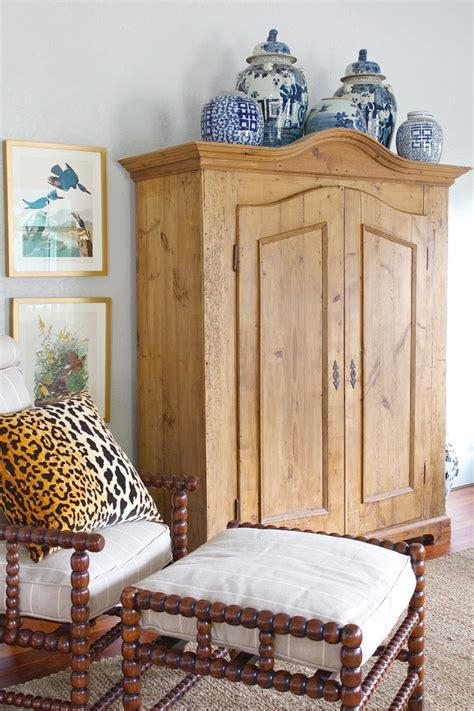decorating armoire tops decorating top of curio cabinet decor accents