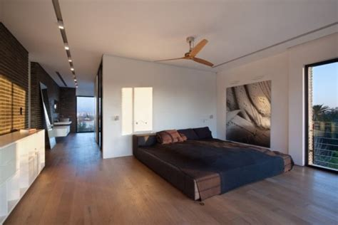 floor level bed wide open plan with interesting elements